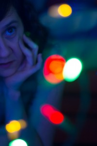 One Christmas I wanted to shoot some portraits with strings of blurred Christmas lights for a bokeh effect but I needed a wide aperture to blur the lights which made it near impossible to get myself in focus.