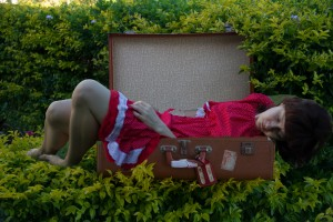 A bad composite - the girl is out of focus but the suitcase is in focus