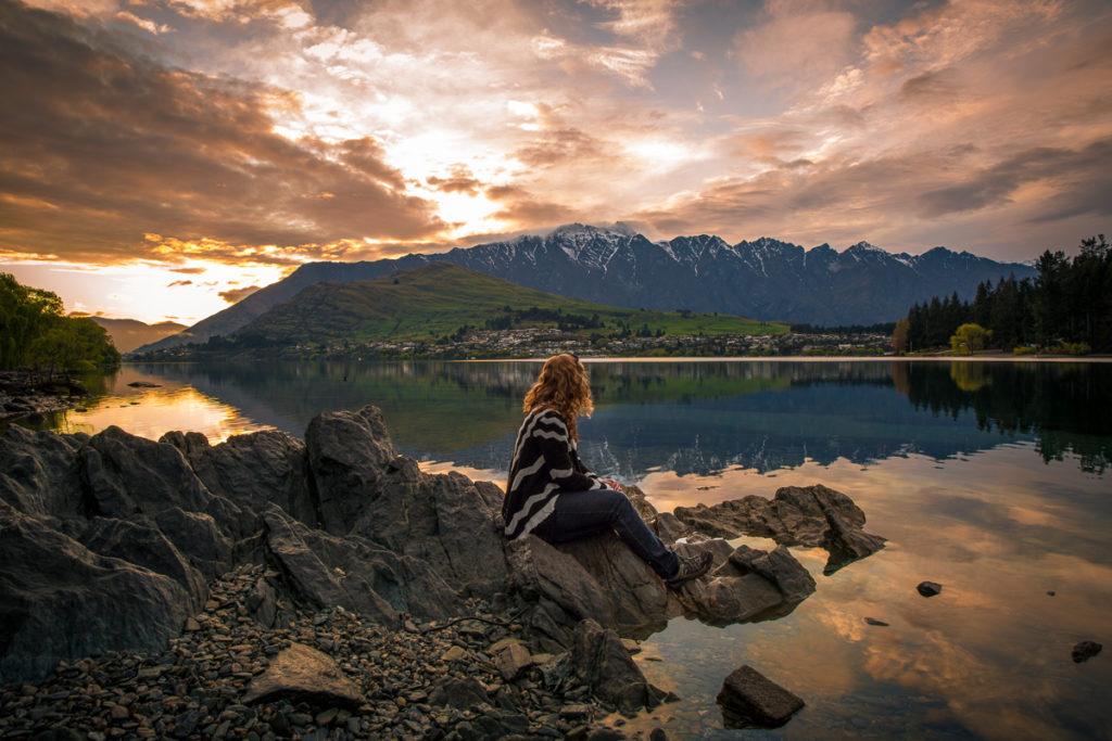 girl overlooking lake at sunrise, queenstown